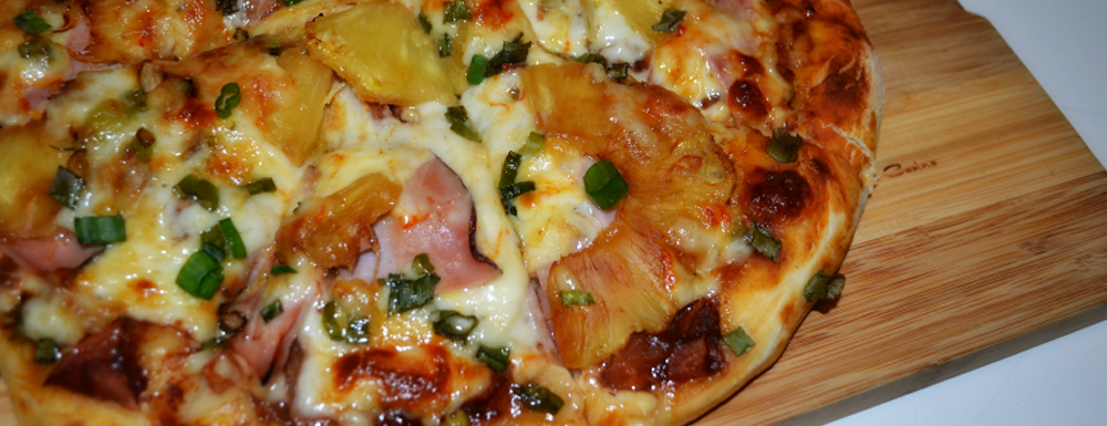 This pizza is YUMMY! This tasty Hawaiian BBQ Pizza is simple enough for a week night dinner and movie in. With a little prep, you will be enjoying this sweet and spicy twist of a pizza!